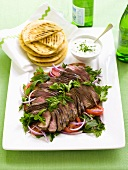 Lamb with tomato salad and minted yoghurt