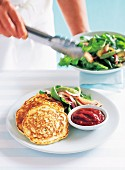 Corn fritters with rocket salad