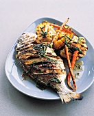 Grilled fish with vegetables and chilli and basil butter sauce