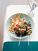 Teriyaki lamb skewers with carrot and bean sprout salad