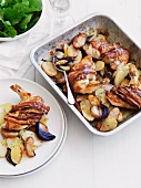 Roast chicken breast wrapped in bacon with apples and potatoes