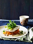 Poached Barramundi fillet on sweet mashed potatoes with a lime and coconut sauce