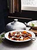 Merguez sausages with a vegetable tajine
