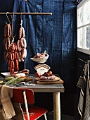 Various types of sausages hanging on butchers hooks
