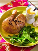 Chicken leg with vanilla sauce and tender vegetables
