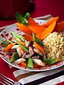 Beef with pumpkin, beans and couscous