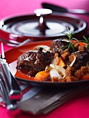 Pork cheek in beer sauce with carrots and croutons