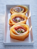Chicken in ham and melon rolls