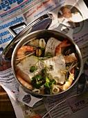 Pot au feu with seafood, turbot and green mango