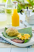 Dominican breakfast: banana puree, scrambled egg and baked cheese