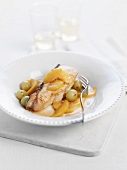 Halibut with peach slices and grapes