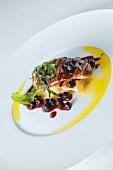 Goose liver with butter sauce and blueberries