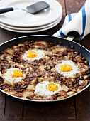 Beef and Potato Hash with Eggs; In a Skillet