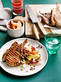 Grilled pork cutlets with peach-chicory salad