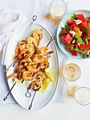 Shrimp kebabs and bread salad with watermelon and feta