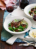 Grilled quail on a bed of salad