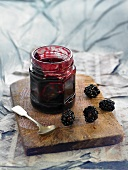 Apple-blackberry marmalade in a marmalade jar
