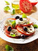 Caprese con le olive (tomatoes with buffalo mozzarella and olives)