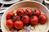 Trusses of tomatoes in a roasting pan