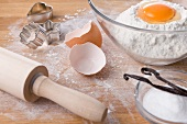 Assorted baking ingredients, cookie cutters and rolling pin