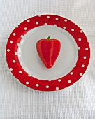 Heart-shaped, red chili pepper on a plate