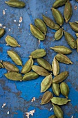 Cardamom seeds on a blue background