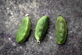Three cardamom seeds