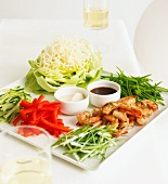Grilled king prawns with salad ingredients