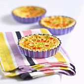 Three mini quiches with vegetables