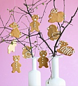 Various Easter biscuits hanging on twigs