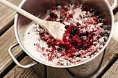 Sugared redcurrants in a pot