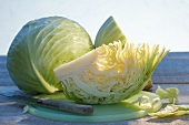 White cabbage, whole and quartered
