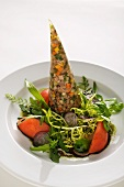 Prime boiled beef in aspic on a bed of mixed leaf salad with a germ oil dressing