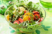 Dandelion salad with oranges and strawberries