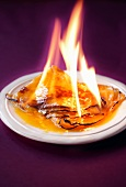 Crepes being flambéed