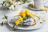 A place setting decorated with kerria
