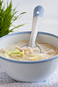 Creamy soup with enoki mushrooms