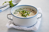 Rice soup with chicken, celeriac and chives