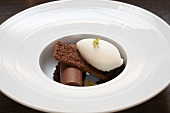 Chocolate Roll with Brownie and Vanilla Ice Cream in a White Bowl