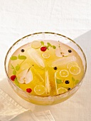 Twenty-Ten Punch with Sliced Fresh Fruit and Mint in a Punch Bowl