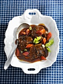 Braised beef cheeks in port wine sauce with rhubarb