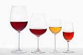 A red wine balloon glass, a large red wine balloon glass, a dessert wine glass and a liqueur wine glass