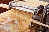 Pasta machine with freshly sliced spaghetti