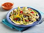 Chicken Taco Salad on a Tortilla; Small Bowl of Salsa