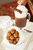 Paper Bag of Sugared Donut Holes; Cappuccino with Foam