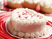 Mini Heart Shaped Cake with White Frosting and Pink red and White Candy Hearts