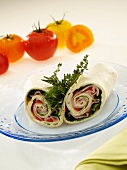 Halved Ham Wrap with Lettuce and Tomatoes; Fresh Herbs