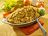 Cornbread Stuffing in a Serving Bowl with Spoon