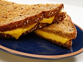 Halved Grilled Cheese Sandwich on Multi Grain Bread