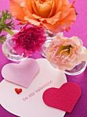 Heart decorations with Valentine's day greetings and flowers
